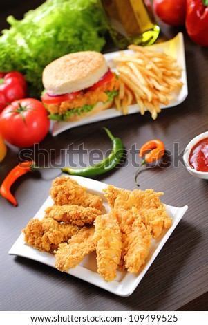 Crispy chicken, burger and french fries. - stock photo