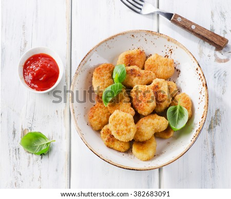 Crispy chicken nuggets with tomato sauce. Top view - stock photo