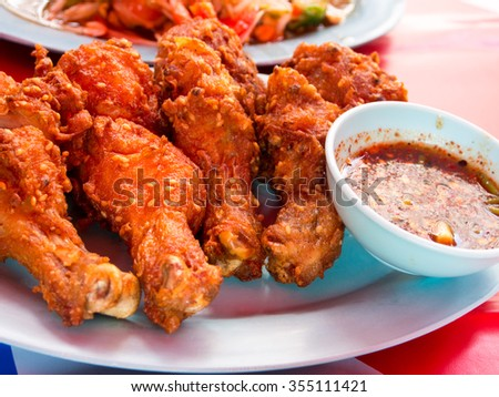 Crispy chicken with sauce - stock photo