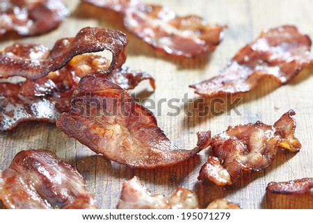 Crispy Cooked Bacon On Wooden Table, Close Up - stock photo