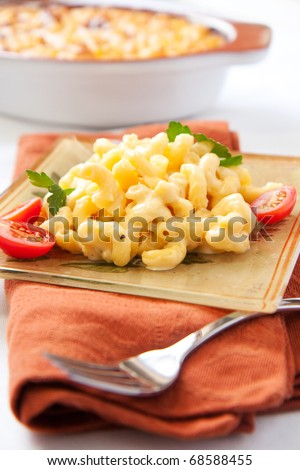 crispy, creamy, and cheesy macaroni and cheese is great for one and all! - stock photo