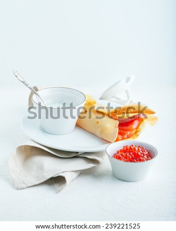 Crispy crepes with smoked salmon  and  cream cheese, caviar. Gluten free. Flour from rice. - stock photo