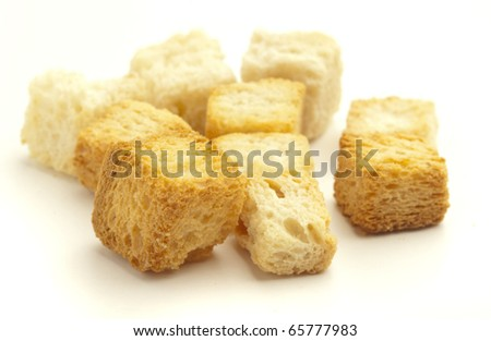 crispy croutons isolated on a white background - stock photo