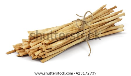 Crispy crunchy long bread sticks tied with rope, isolated on a white background. - stock photo