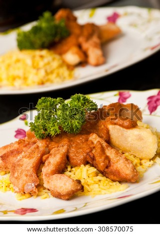 """Crispy fish """"fingers"""" with curry sauce and rice - stock photo"""