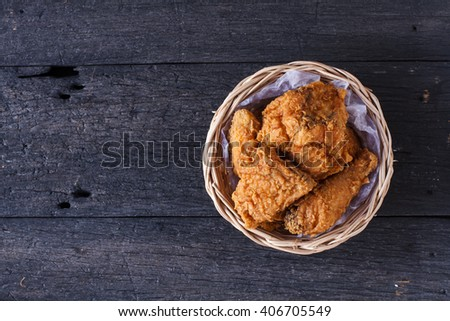 Crispy fried chicken in a basket on wooden table.Top view style - stock photo