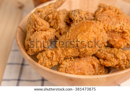 crispy fried chicken on wood plate - stock photo