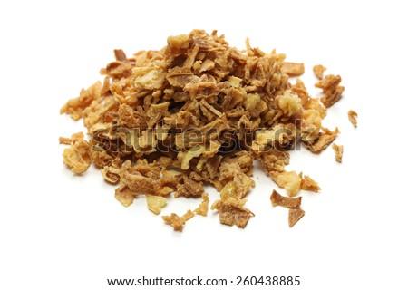 crispy fried onion flakes on white background - stock photo