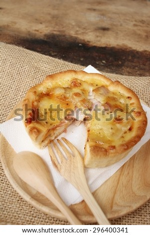 Crispy homemade Pizza on background of brown.