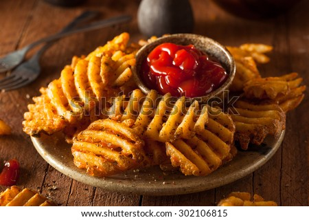 Crispy Homemade Waffles Fries with Organic Ketchup - stock photo