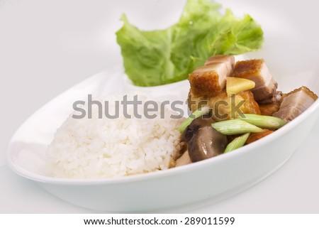 Crispy layered pork rice with mushroom sauces - stock photo
