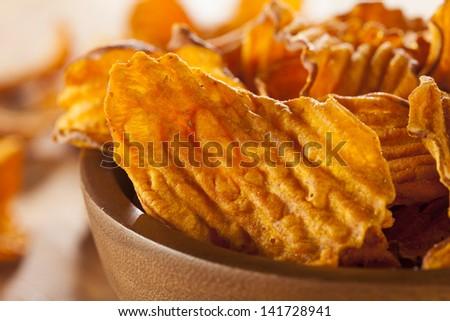 Crispy Orange Sweet Potato Chips with sea salt - stock photo