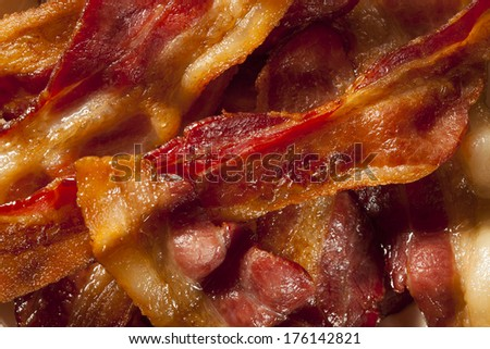 Crispy Organic Unhealthy Bacon on a Background - stock photo