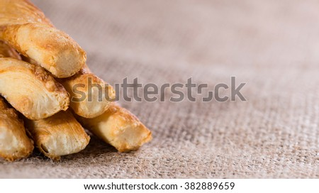 Crispy Pastry Sticks on wooden background (close up shot, selective focus)
