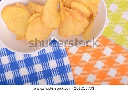 Crispy Peruvian sweet potato chips in white ceramic bowl - stock photo