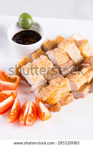 crispy pork belly with soy sauce and calamansi to dip