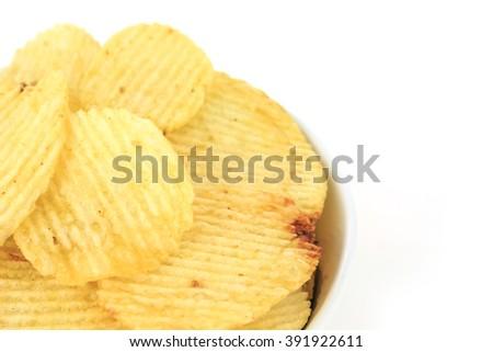 crispy potato chips junk food unhealthy food on bowl white background - stock photo