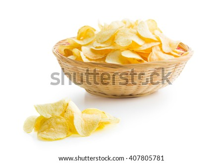 Crispy potato chips on white background - stock photo