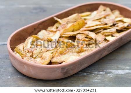 Crispy potato skins in crockery, snack food - stock photo