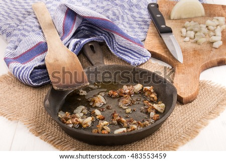 crispy roasted finely chopped onion with oil in a cast iron pan