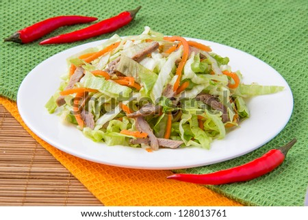 Crispy salad with pork, korean carrots and lettuce