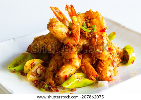 crispy shrimp with pepper and onion - stock photo