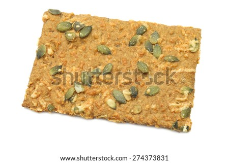 crispy spelt crackers with pumpkin seeds and cheese on a white background - stock photo