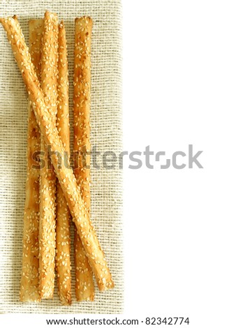 crispy sticks with sesame on napkin isolated on white background - stock photo