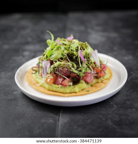 Crispy tuna taco with tomatillo and avocado salsa with pickled jalapeno  - stock photo