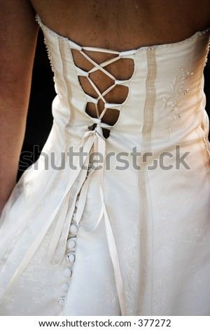 Criss crossed wedding dress. shot of the bride's back - stock photo