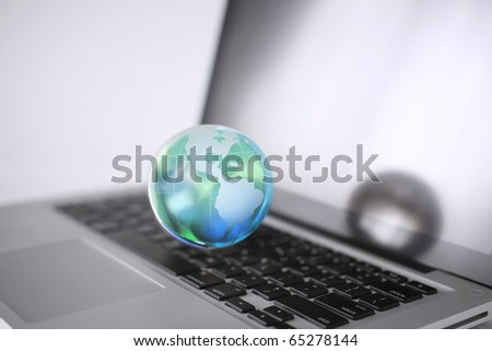 Cristal globe of the Earth on a Computer - stock photo