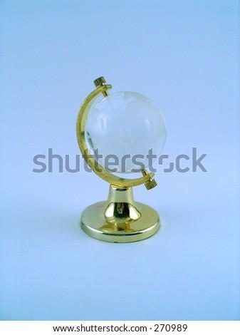 cristal globe on blue background - stock photo
