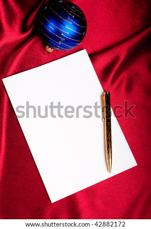 Cristmas theme. Pen, paper and blue ball. - stock photo
