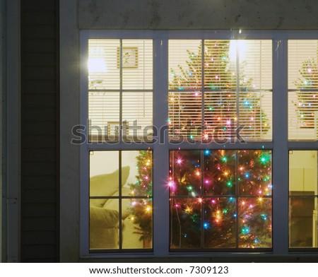 cristmas tree inside of a house - stock photo