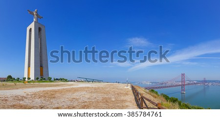 Cristo-Rei or King-Christ Sanctuary in Almada with a view over the Tagus River and the 25 de Abril bridge. Three iconic elements of the city of Lisbon, Portugal. - stock photo
