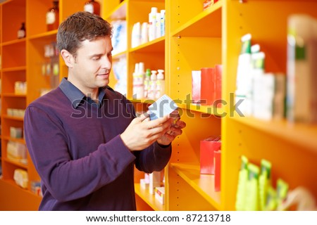 Critical man checking some products in a pharmacy - stock photo