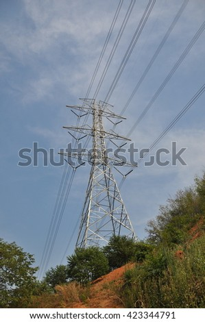 Critical 500,000 volts transmission tower due to land sliding. - stock photo