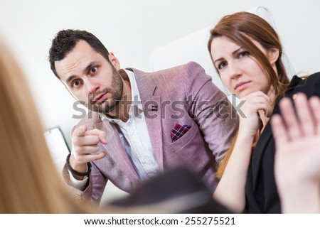 Criticism at work by colleagues. Man with assistant criticize a colleague. - stock photo