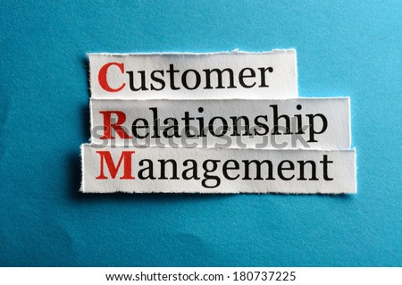 CRM customer relation management abbreviation on blue paper