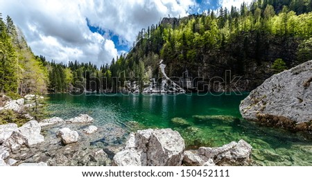 Crno jezero (Black lake), the lowest of all the Triglav Lakes. The Julian Alps are a mountain range of the Southern Limestone Alps that stretches from northeastern Italy to Slovenia.  - stock photo