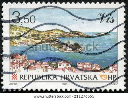 CROATIA - CIRCA 2000: a stamp from Croatia shows image of a coastal landscape, circa 2000 - stock photo