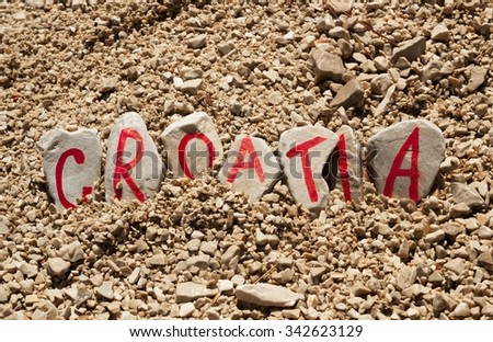 Croatia country name made of painted stones on the beach - stock photo