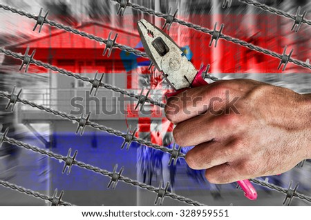 Croatia flag, migrants, border house and barb wire with pliers