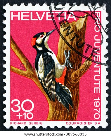 CROATIA ZAGREB, 7 FEBRUARY 2016: a stamp printed in the Switzerland shows Greater Spotted Woodpecker, Dendrocopos Major, Bird, circa 1970 - stock photo