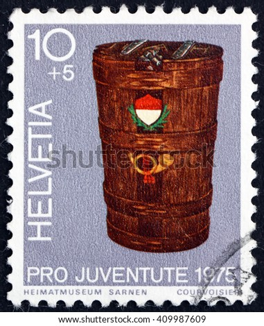 CROATIA ZAGREB, 21 FEBRUARY 2016: a stamp printed in the Switzerland shows Mail Bucket, circa 1975 - stock photo
