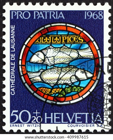 CROATIA ZAGREB, 21 FEBRUARY 2016: a stamp printed in the Switzerland shows Pisces, Design from Rose Window, Lausanne Cathedral, circa 1968 - stock photo