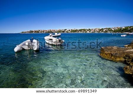 croatian coastline and boats docked in bay - stock photo