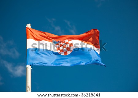 Croatian flag against blue sky - stock photo