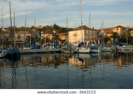 Croatian harbor in the evening - stock photo