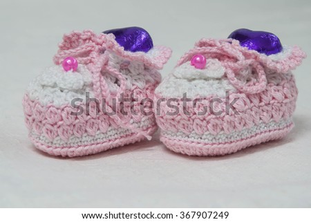 crochet baby booties on white background - stock photo